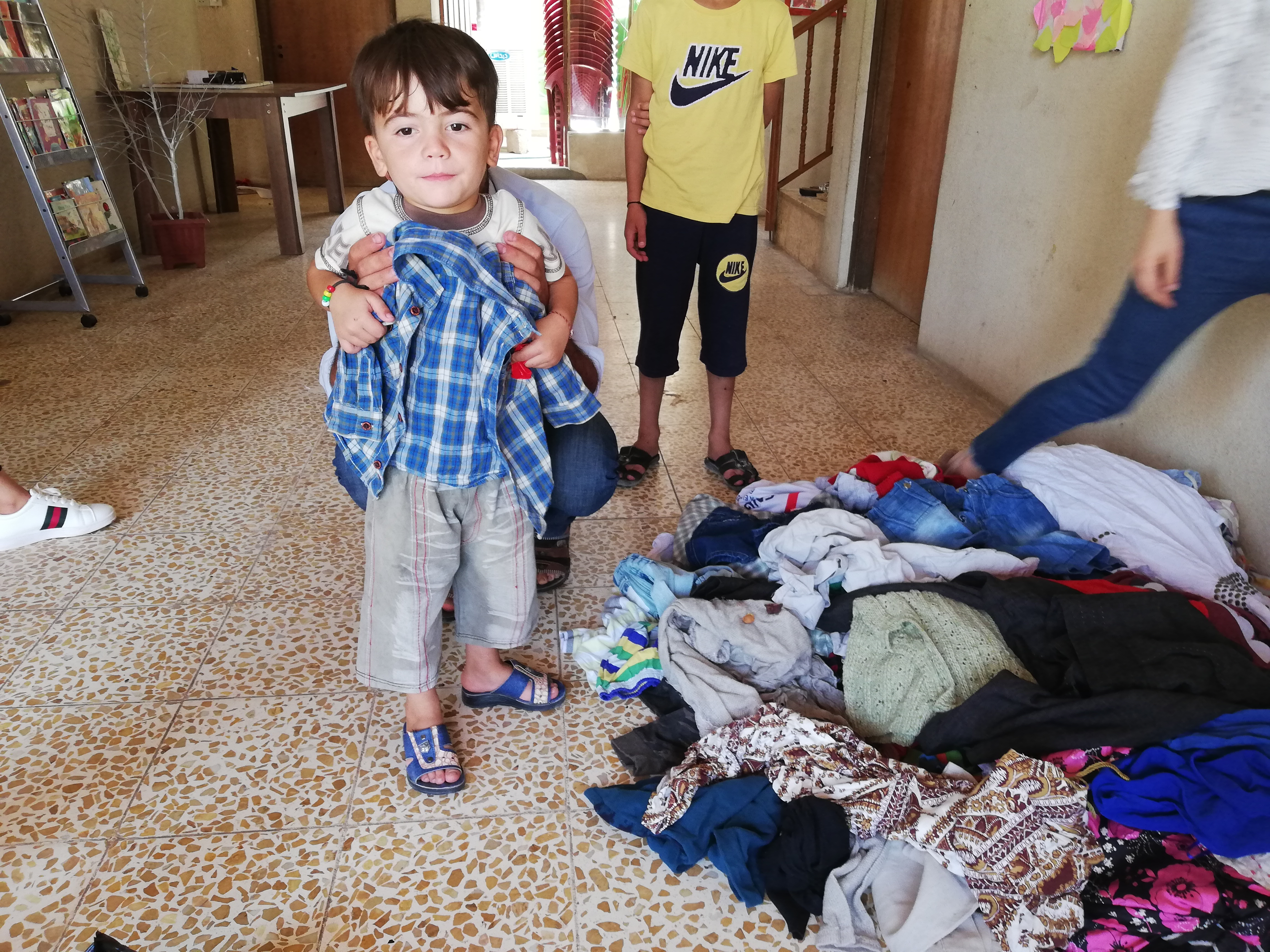 Giving out summer clothes to Haven kids